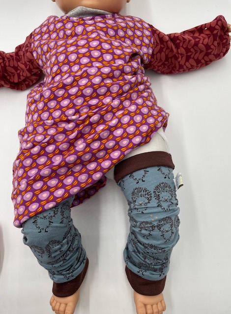 Baissez le babygown (comme sur la photo) ou tee-shirt, ou autre vêtement.